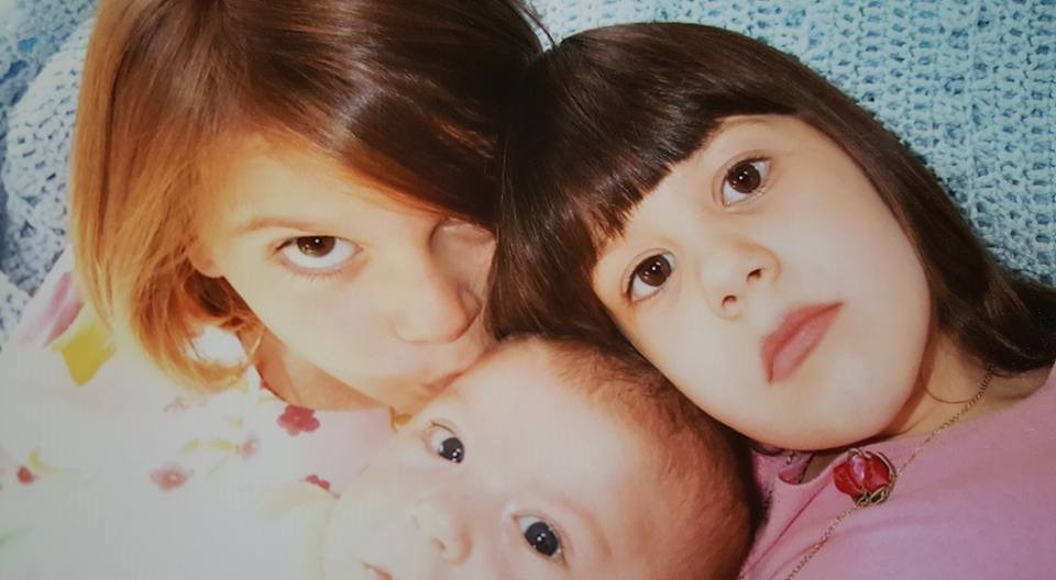 "Pic of my three shortly after Theo was born. I believe the expression Sophia is sporting is called ""Ambivalence""."